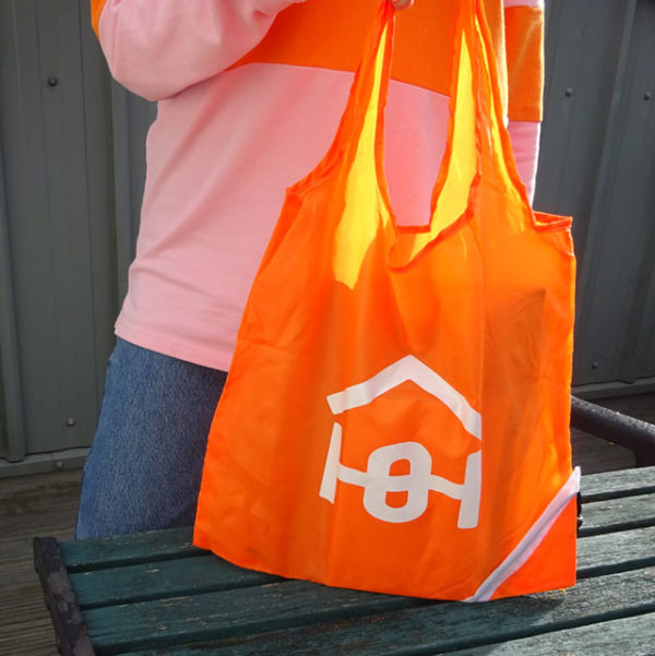 Orange bag with Homeless Oxfordshire logo | Homeless Oxfordshire shop