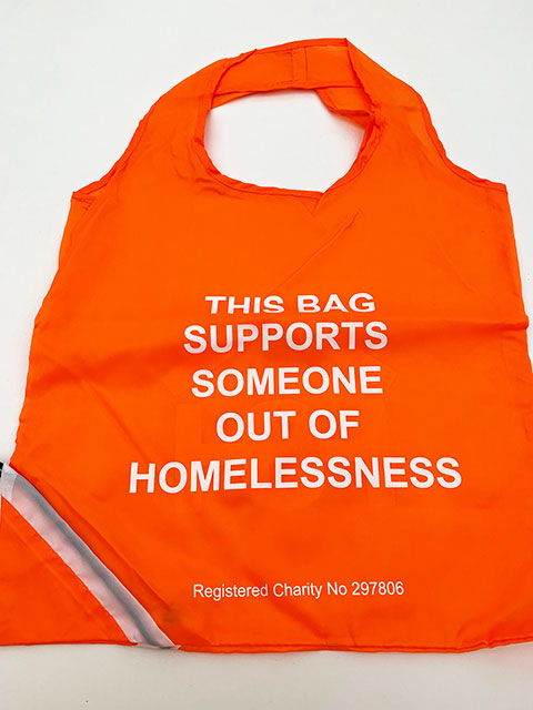 Orange bag with Homeless Oxfordshire slogan | Homeless Oxfordshire shop
